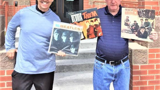 """Eli """"Boda"""" DeBono, left, and Mark """"Boz"""" Bosley, with some treasures from the golden era of music known as the British Invasion."""