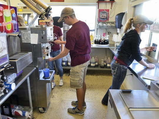 Mr. Twisty employees serve up ice cream and other treats for customers Thursday at the St. Cloud restaurant.