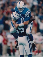 Jim Harbaugh leaps into the arms of Quentin Coryatt after Harbaugh's third-quarter touchdown pass. The Colts beat the San Francisco 49ers, 18-17 on Oct. 15, 1995.
