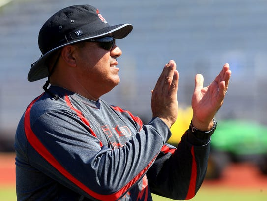 West Oso's head coach Pete Guajardo talks to his players