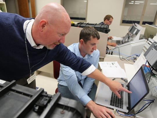 Lakeshore Technical College Electro-Mechanical instructor Wade Wittmus points out something to student Eric Schmitz Sept. 7 at LTC in Cleveland, Wisconsin.