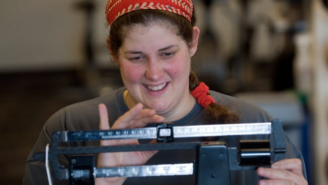 In this 2011 photo, Tami Breazeale monitors her progress by weighing in during a workout at the YMCA in Hastings, Minn. Breazeale had lost 65 pounds, after being diagnosed as pre-diabetic and was  participating in a year long program through the YMCA designed to prevent Diabetes through lifestyle changes which include increasing activity and changing the diet.