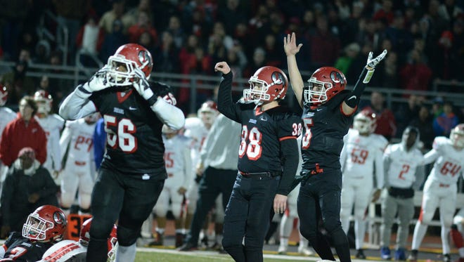 Lenape's Stephen Mulville, 38, reacts as he kicks a 33-yard field goal to give the Indians a 10-7 lead with 7 seconds left during Saturday night's South Jersey Group 5 championship against Rancocas Valley at Rowan University in Glassboro.