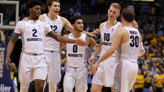 Marquette is losing Andrew Rowsey (right) to graduation, but next season the Golden Eagles will bring back (from left) Sacar Anim, Matt Heldt, Markus Howard and Sam Hauser.