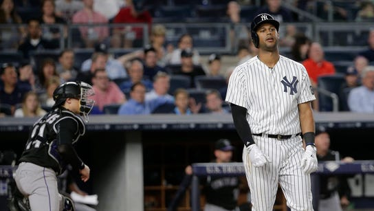 New York Yankees' Aaron Hicks reacts after striking