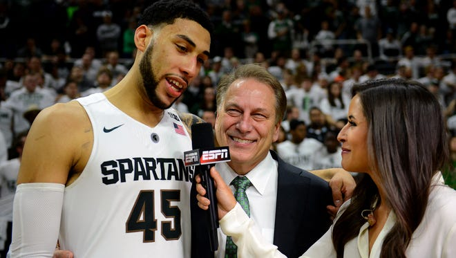 Spartans head coach Tom Izzo smiles as forward Denzel Valentine gives a post-game interview after the Spartans' 91-76 victory over the Ohio State Buckeyes Saturday, March 5, 2016 at the Breslin Center.