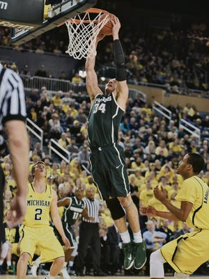 Gavin schilling makes a shot  as Michigan takes on MSU at Crisler Arena.