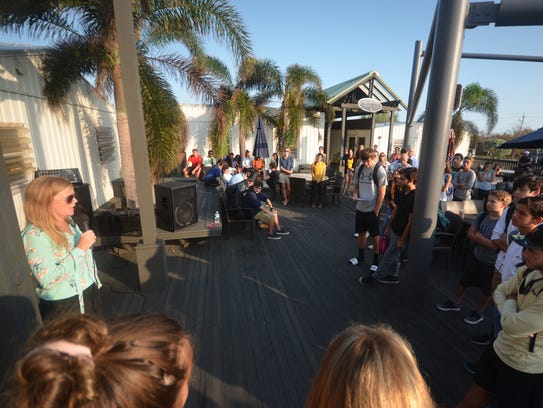 File: Marco Island Academy principal Melissa Scott addresses students and faculty before the flag raising. MIA, the island's charter high school, marked their first day of classes after Hurricane Irma with a ceremony featuring a flag that had flown in war zones, and was promised to help the school weather the storm.