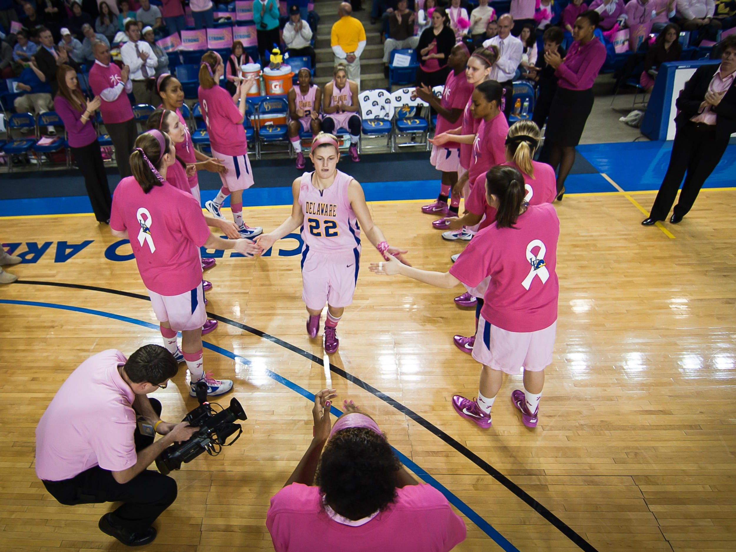 Delaware Junior Guard #22 Lauren Carra is introduced to the crowed prior to the start of a Colonial Athletic Association conference Basketball Game against the VCU Rams.