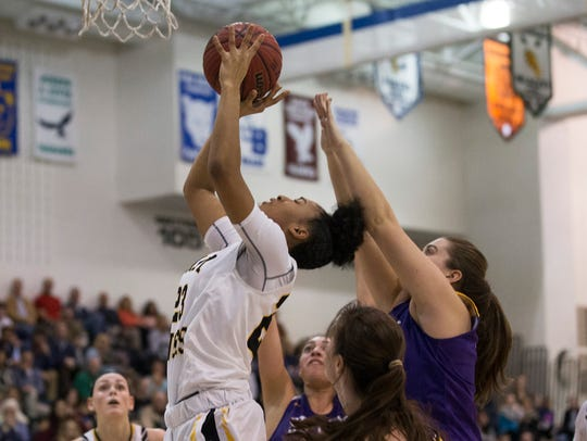 St John Vianney's  Sajada Bonner goes up with shot.