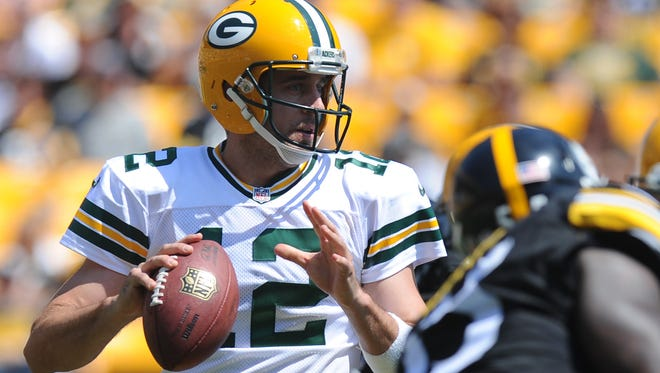 Green Bay Packers quarterback Aaron Rodgers (12) passes in the first quarter of the preseason NFL game against the Pittsburgh Steelers, Sunday, Aug. 23, 2015 in Pittsburgh.