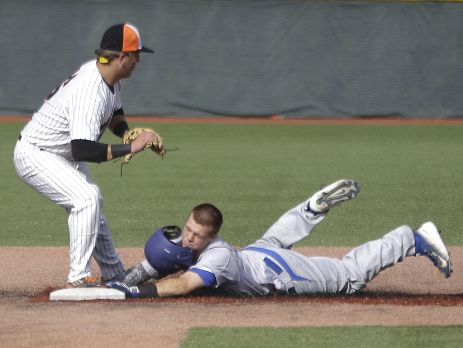 Summit's Eric Terry slides into second base with a double during their 2-1 win over Waynesville, Friday, May 29,2015. (Photo by Tony Tribble)