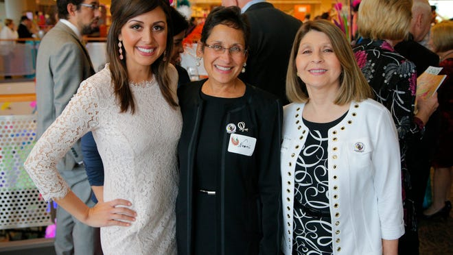 Amanda Gomez of KION-TV in Salinas, Naomi and Elvira Diaz-Infante during the 2015 Party in the Library fundraiser for the Hartnell College Foundation on Saturday, May 9, inside the Hartnell College Library in Salinas. The party featured dinner, auction and dancing into the night.