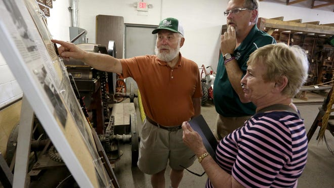 Ingwal S. Horgen Farm Museum curator Randy Block, center, museum volunteer, Roger Thorpe of the town of Easton and Judy Horgen of Milford, CT, daughter-in-law of Ingwal Horgen, look at old newspaper clippings about the museum at the museum in Marathon Park in Wausau, Thursday, July 2, 2015.