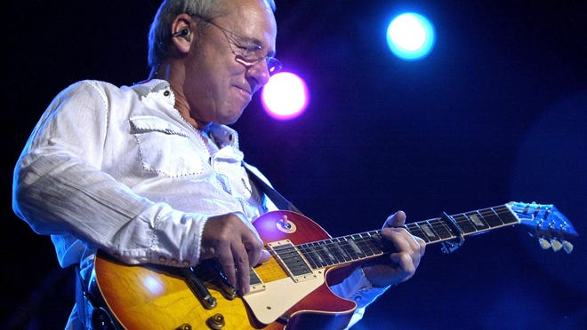 Dire Straits lead guitarist Mark Knopfler performs at a concert in Bombay, India.