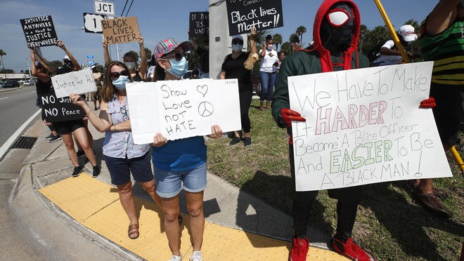 Protesters prepare to march across the Dunlawton Bridge in Port Orange, Sunday, May 31, 2020.