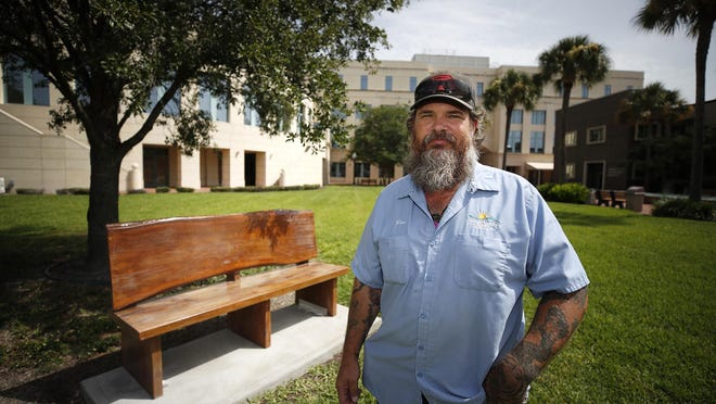 Ben Muni, a longtime tradesworker for Volusia County, used a mix of power and hand tools to create the bench that sits outside the county's administration center. The bench was crafted from the trunk of an old live oak that couldn't be saved due to fungal disease.