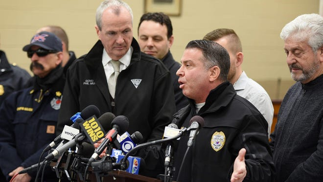 Elmwood Police Chief Michael Foligno flanked by Gov. Phil Murphy during a 2019 press conference.