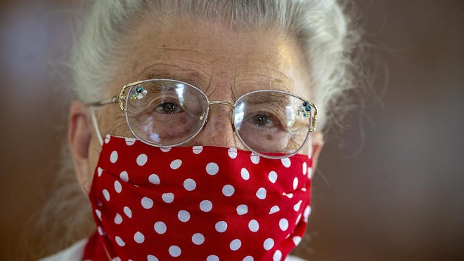 On July 7, Mae Krier, 94, of Levittown, Bucks County, wears one of the face masks she created.