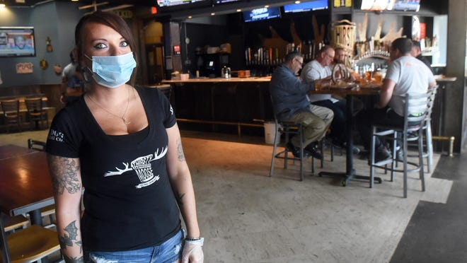 Katie Eaton, assistant manager for Thirsty Moose Tap House in Dover, and her staff are implementing restrictions due to the coronavirus pandemic and following state guidelines. Seating is limited to 50% of tables and there is no bar service. The bartender on duty makes drinks for wait staff to deliver to tables.