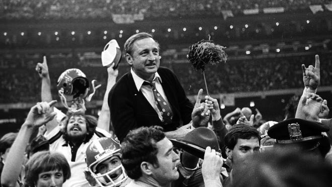 Georgia football coach Vince Dooley is carried off the field after Georgia defeated Notre Dame in the 1981 Sugar Bowl.