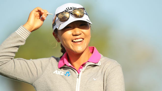 Lydia Ko, who is currently the top ranked player on the LPGA tour, smiles while putting her tee in the back of her cap after hitting her drive on the twelfth hole during the first round of the ANA Inspiration on Thursday, April 2, 2015 at Mission Hills Country Club in Rancho Mirage, Calif. Ko finished the day shooting a round of 71, one under par. She extended her streak of consecutive rounds under par to 29, tying the statistic's all-time record.