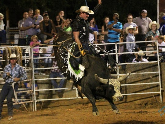 Preston Fowlkes III rides a bull during a Lone Star Rodeo Company show during a previous show. The show comes to Salisbury on Jan. 20-21, 2017.