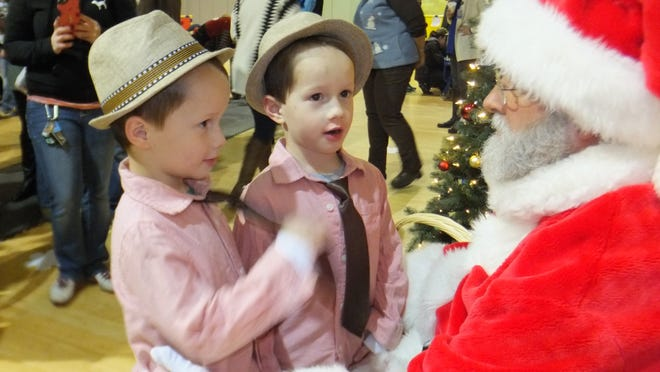Four-year-old twins Josh and Jeremiah Long share with Santa what they would like for Christmas.
