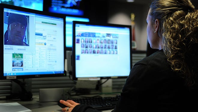 Nicole Hardy-Smith with the Palm Beach Sheriff's Office, uses a facial recognition software tool to provide identity resolution on cold cases.(Carline Jean/ Sun Sentinel/TNS)