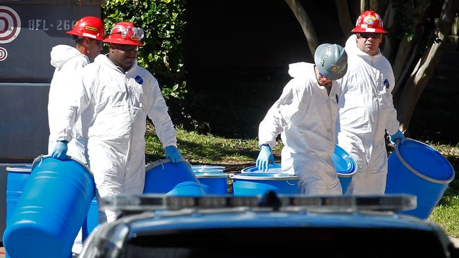 Hazmat workers decontaminate an Ebola victim's apartment in Texas.