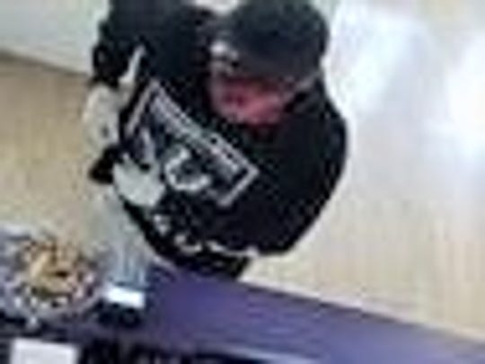 A man robs a Metro PCS shop on April 13 at 2920 N.