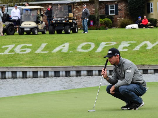 Matt Fast reads a putt during the third round golf of the 2016 Chitimacha Louisiana Open on Saturday at LeTriomhe.