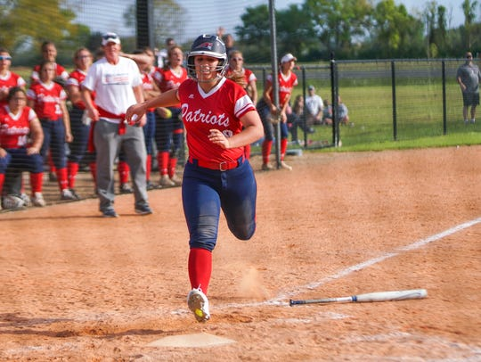 North Vermilion's Holly Necaise tags home plate as