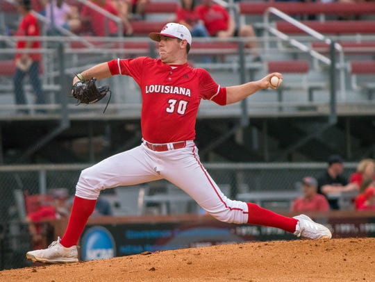 UL's Hogan Harris throws the ball to the batter as