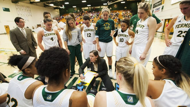 Vermont head coach Lori McBride talks to the team during a timeout earlier this season.