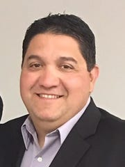 Scott Veliz was hired as Oñate's new head football
