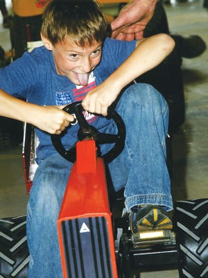 Levi Kindschi pedals at a previous championship pedal tractor pulling contest.