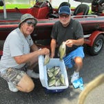 Successful July crappie anglers, Ron Daugherty, Carl Junction, left and Jay Ellis, Webb City, with 27 keeper crappie they caught.