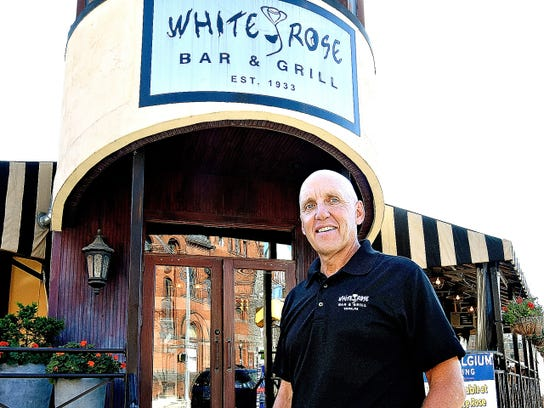 Third-generation owner Tom Sibol, shown recently outside the White Rose Bar and Grill, took over the downtown York business from his parents in 1984. At that time, the business had four employees. Now, it employs 105.