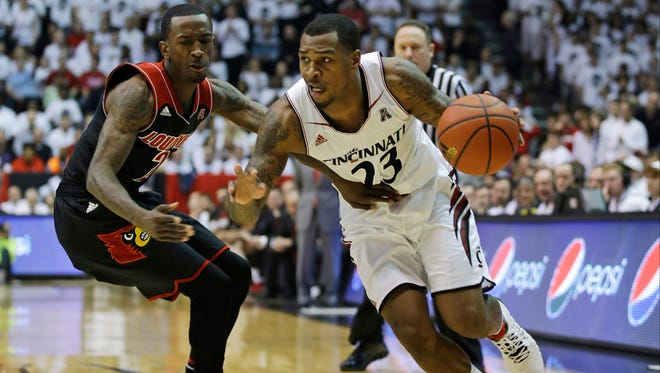 In this Feb. 22 file photo, Cincinnati guard Sean Kilpatrick (23) drives past Louisville guard Russ Smith in the first half of a college basketball game in Cincinnati. Kilpatrick was selected to The Associated Press All-America team, released Monday.