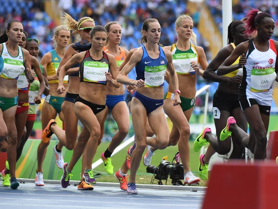 Molly Huddle, center, competes in the women's 10,000-meter