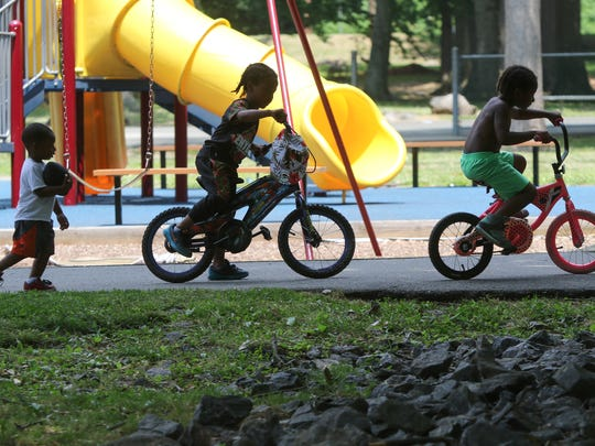 (left to right) 2 year-old Ezekiel Morehead, runs behind Zion Miles and   Namir Dula, both 5, who were playing at Haynes Park.