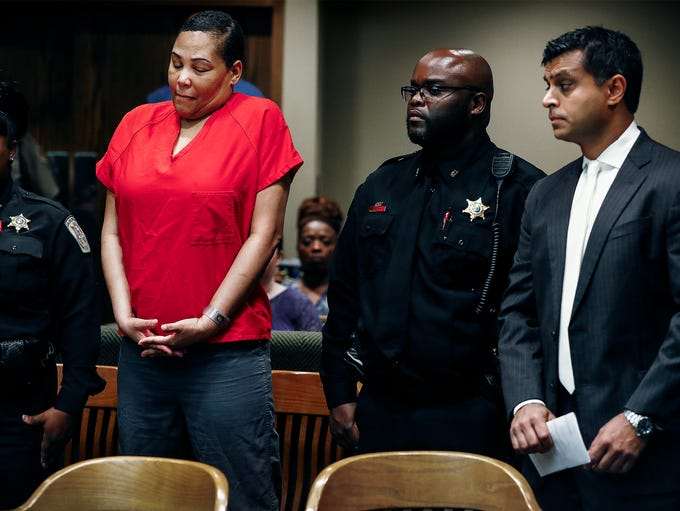 Sherra Wright (left) stands in court while Judge Lee