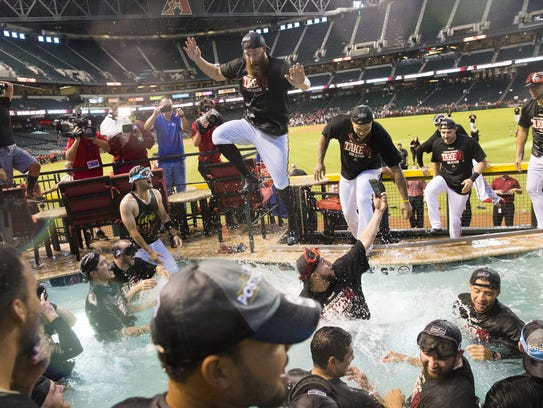 Arizona Diamondbacks players celebrate in the pool