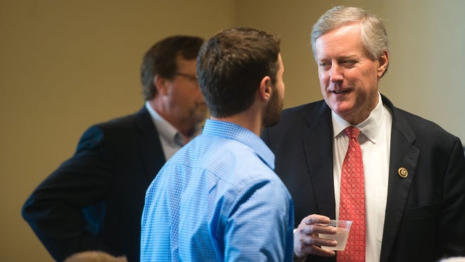 U.S. Rep. Mark Meadows chats with an unidentified man before addressing the Council of Independent Business Owners  and answering questions Friday at UNC Asheville.
