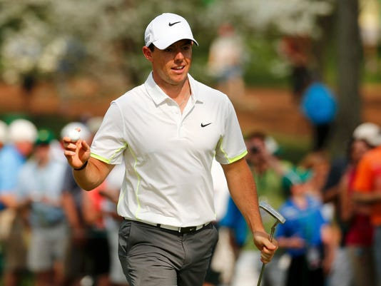 Rory McIlroy of Northern Ireland holds up the ball on the seventh green during the par 3 event held ahead of the 2015 Masters at Augusta National Golf Course in Augusta