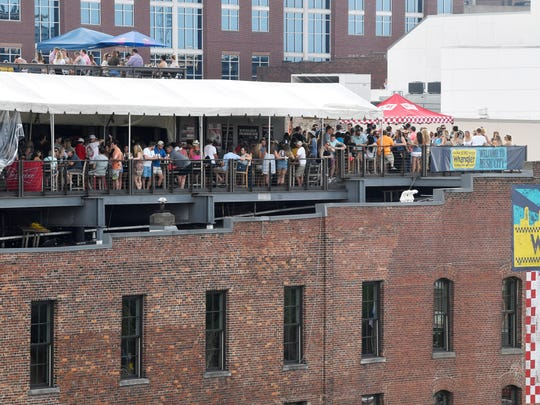 Fans fill the rooftop at Acme Feed and Seed as they enjoy the 2018 CMA Music Fest Saturday June 9, 2018, at Nissan Stadium in Nashville, Tenn. Part of the bar's rooftop deck collapsed in October.