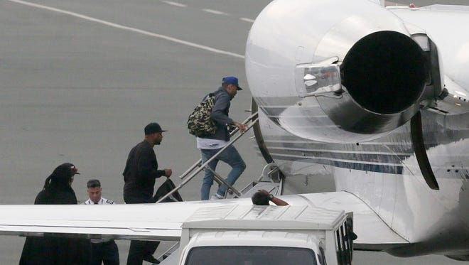 Grammy award-winning singer Chris Brown boards a chartered jet at the old Manila Domestic Airport in suburban Pasay city, south of Manila, Philippines, Friday, July 24, 2015.