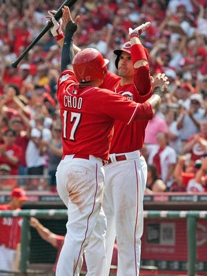 Sep 7, 2013; Cincinnati, OH, USA; Cincinnati Reds center fielder Shin Soo Choo (17) high fives Joey Votto (19) after scoring during the bottom of the 7th inning of the Reds 4-3 win over the Los Angeles Dodgers at Great American Ball Park. Mandatory Credit: Rob Leifheit-USA TODAY Sports
