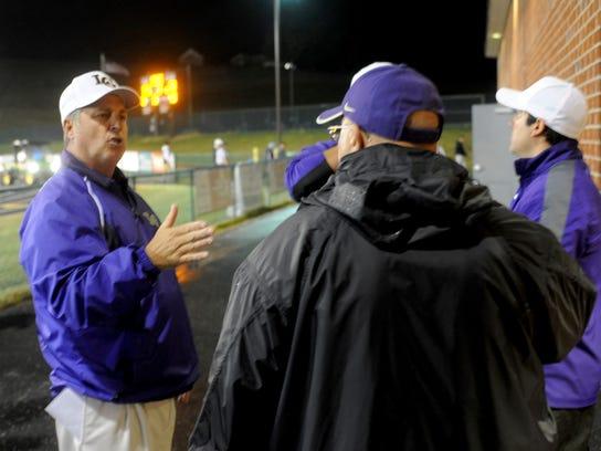 Waynesboro head coach Derek McDaniel talks with assistant